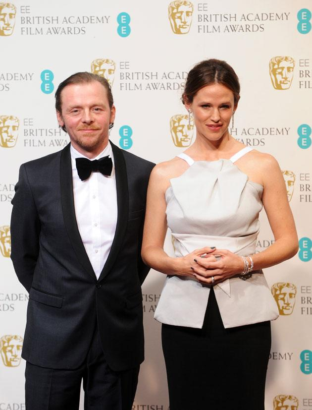 Presenters Simon Pegg and Jennifer Garner pose in the press room at the EE British Academy Film Awards at The Royal Opera House on February 10, 2013 in London, England. (Photo by Stuart Wilson/Getty Images)