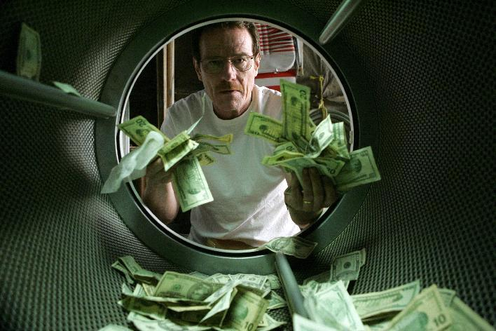 """This image released by AMC shows Bryan Cranston as Walter White laundering money in the pilot episode of """"Breaking Bad."""" The series finale of the popular drama series airs on Sunday, Sept. 29. (AP Photo/AMC, Doug Hyun)"""