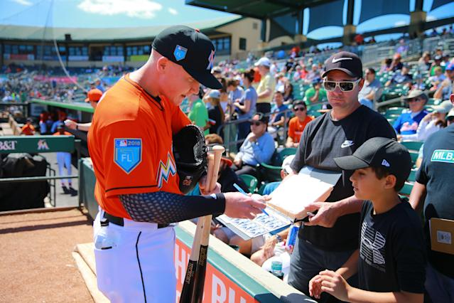 <p>Miami Marlins prospect Brian Anderson signs autographs for fans before the baseball game against the New York Mets at Roger Dean Chevrolet Stadium in Jupiter, Fl., March 3, 2018. (Photo: Gordon Donovan/Yahoo News) </p>