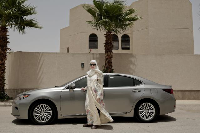 A woman who signed up to be a driver for a ride-hailing service stands next to her car in Riyadh, Saudi Arabia. (Photo: Nariman El-Mofty/AP)