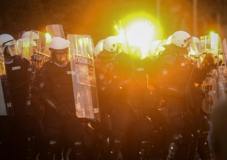 Protestors clash with police in Belgrade on July 8, 2020 as violence erupts against a weekend curfew announced to combat a resurgence of COVID-19 infections