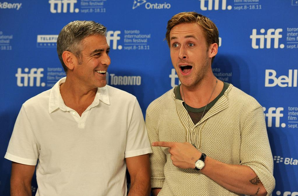 """<a href=""""http://movies.yahoo.com/movie/contributor/1800019715"""">George Clooney</a> and <a href=""""http://movies.yahoo.com/movie/contributor/1804035474"""">Ryan Gosling</a> goof around at the 2011 Toronto Film Festival press conference for <a href=""""http://movies.yahoo.com/movie/1810155680/info"""">The Ides of March</a> on September 9, 2011."""