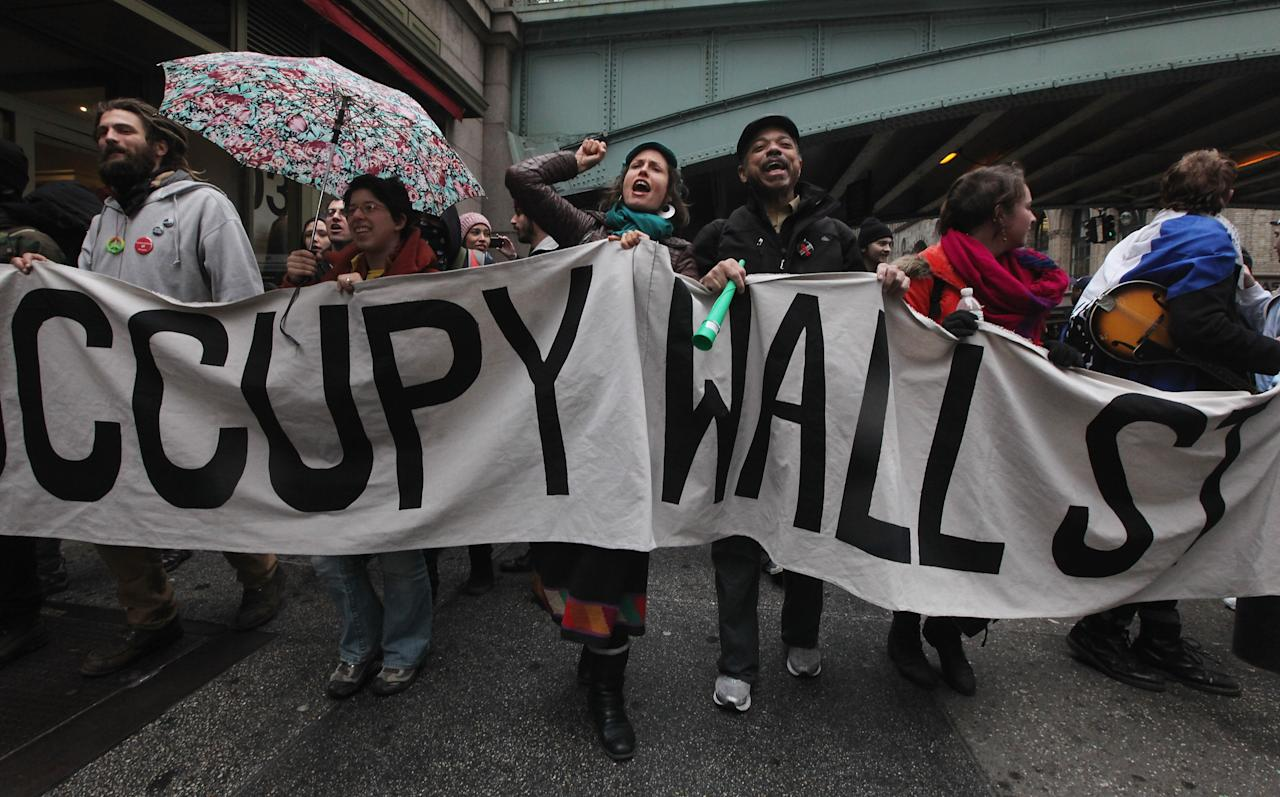 """NEW YORK, NY - FEBRUARY 29:  Protesters demonstrate during an Occupy Wall Street """"Shut Down the Corporations"""" protest on February 29, 2012 in New York City. Occupy movements across the country are planning protests in dozens of cities against corporate power.   (Photo by Mario Tama/Getty Images)"""