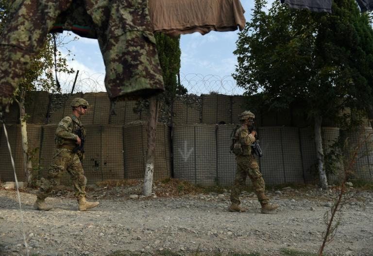 US soldiers patrol in front of an Afghan army base in August 2015 in eastern Nangarhar province