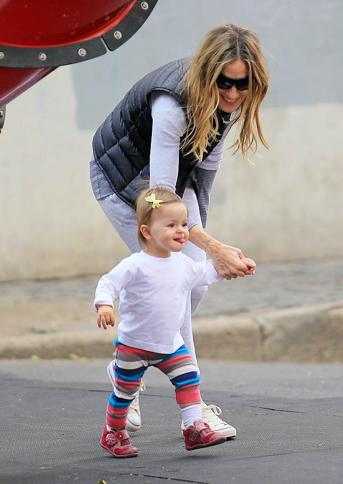 """Sarah Jessica Parker lent one of her 18-month-old twin daughters -- either Marion or Tabitha -- a hand while running around a NYC playground. Jackson Lee/<a href=""""http://www.splashnewsonline.com"""" target=""""new"""">Splash News</a> - October 23, 2010"""