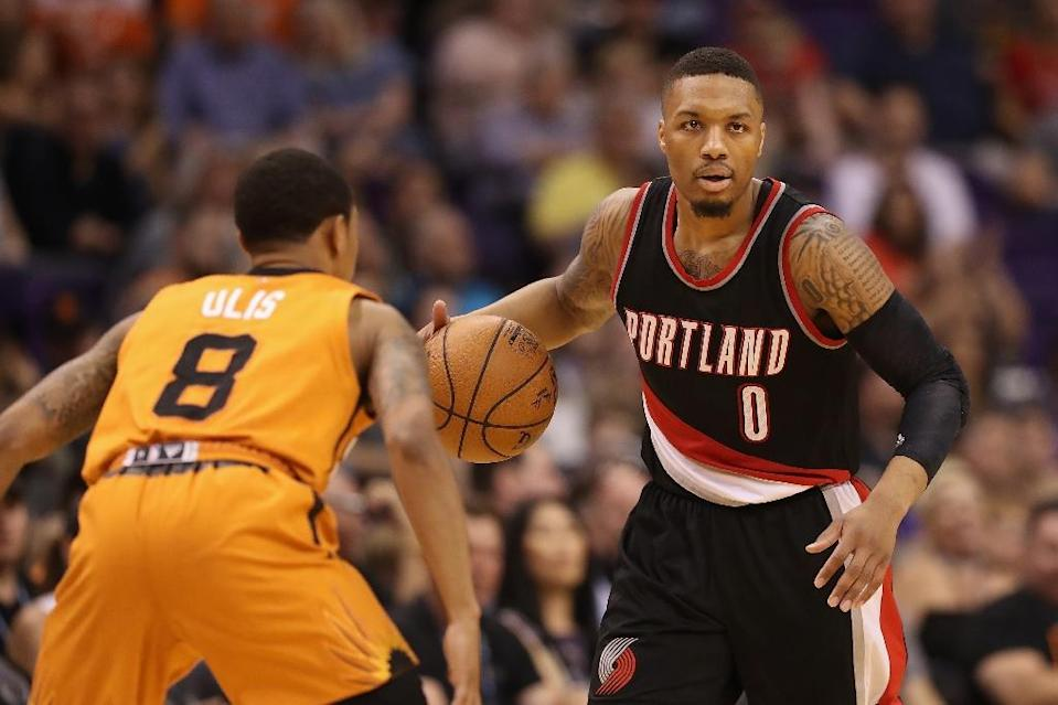 Portland led by 23 points just 10 minutes into the game against Atlanta and rolled to victory behind 27 points from Damian Lillard (R) and 22 from fellow guard CJ McCollum (AFP Photo/Christian Petersen)