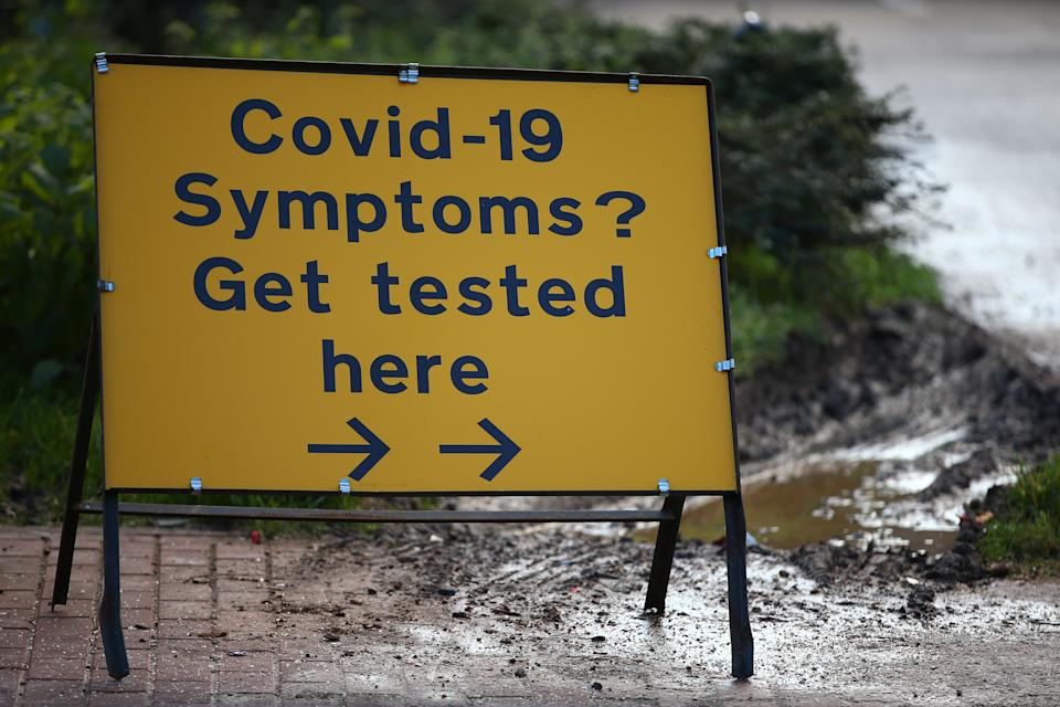LONDON, ENGLAND - JANUARY 23: A sign pointing toward a covid-19 testing centre in Waltham Forest on January 23, 2021 in London, United Kingdom. With a surge of covid-19 cases fueled partly by a more infectious variant of the virus, British leaders have reimposed nationwide lockdown measures across England through at least mid February. (Photo by Hollie Adams/Getty Images)