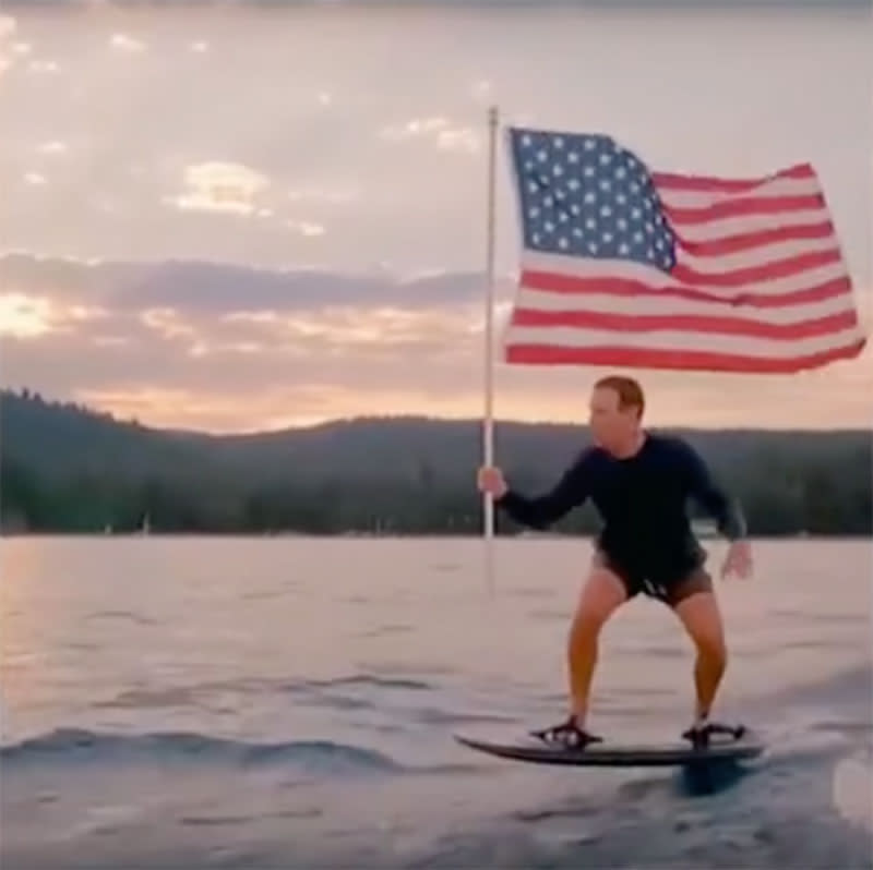 Mark Zuckerberg rides a hydro-foil board while waving an American flag in a 4th July video
