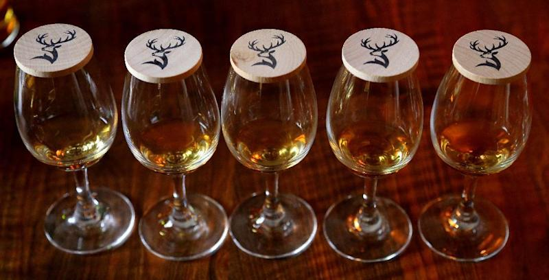 This photo taken June 28, 2016, shows the line up for a whisky tasting at the Glenfiddich distillery in the Speyside region of Scotland. The distillery is one of several in the area that can be visited. (Michelle Locke via AP)