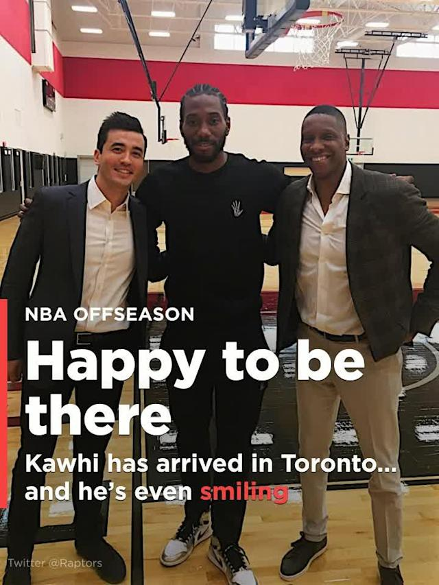 Despite reports that KawhI Leonard did not want to play in Toronto, the two-time NBA All-Star has arrived north of the border, and he is even smiling in the picture.
