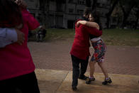 FILE - In this June 6, 2021 file photo, a couple dances tango at a park amid the COVID-19 pandemic lockdown in Buenos Aires, Argentina. Nostalgia for dance makes many tango dancers, or tangueros, defy restrictions with clandestine milongas in closed places or public spaces. (AP Photo/Natacha Pisarenko, File)