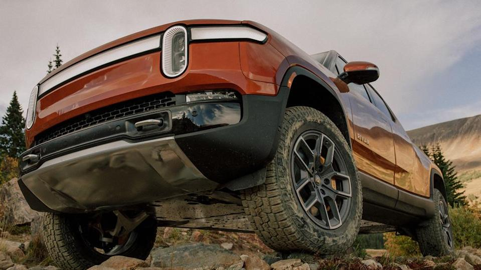 A reinforced underbody and maximum ride height of 14.4 inches helps the R1T clear bigger boulders and rushing streams. - Credit: Photo by Elliot Ross, courtesy of Rivian Automotive LLC.
