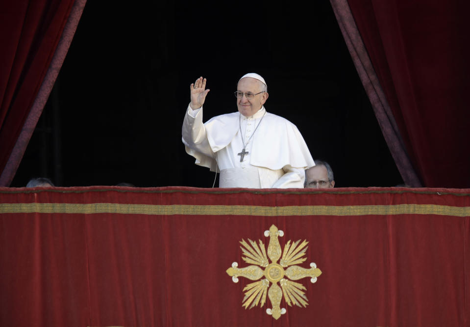 Pope Francis arrives to deliver the Urbi et Orbi (Latin for 'to the city and to the world' ) Christmas' day blessing from the main balcony of St. Peter's Basilica at the Vatican, Tuesday, Dec. 25, 2018. (AP Photo/Alessandra Tarantino)