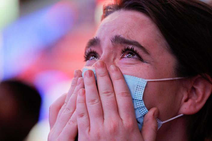 Krista Matheny, 26, of New York City, reacts as she watches a speech by Democratic 2020 U.S. presidential nominee Joe Biden  after news media announced that he has won the 2020 U.S. presidential election, on Times Square in New York City, U.S. November 7, 2020. (Andrew Kelly/Reuters)