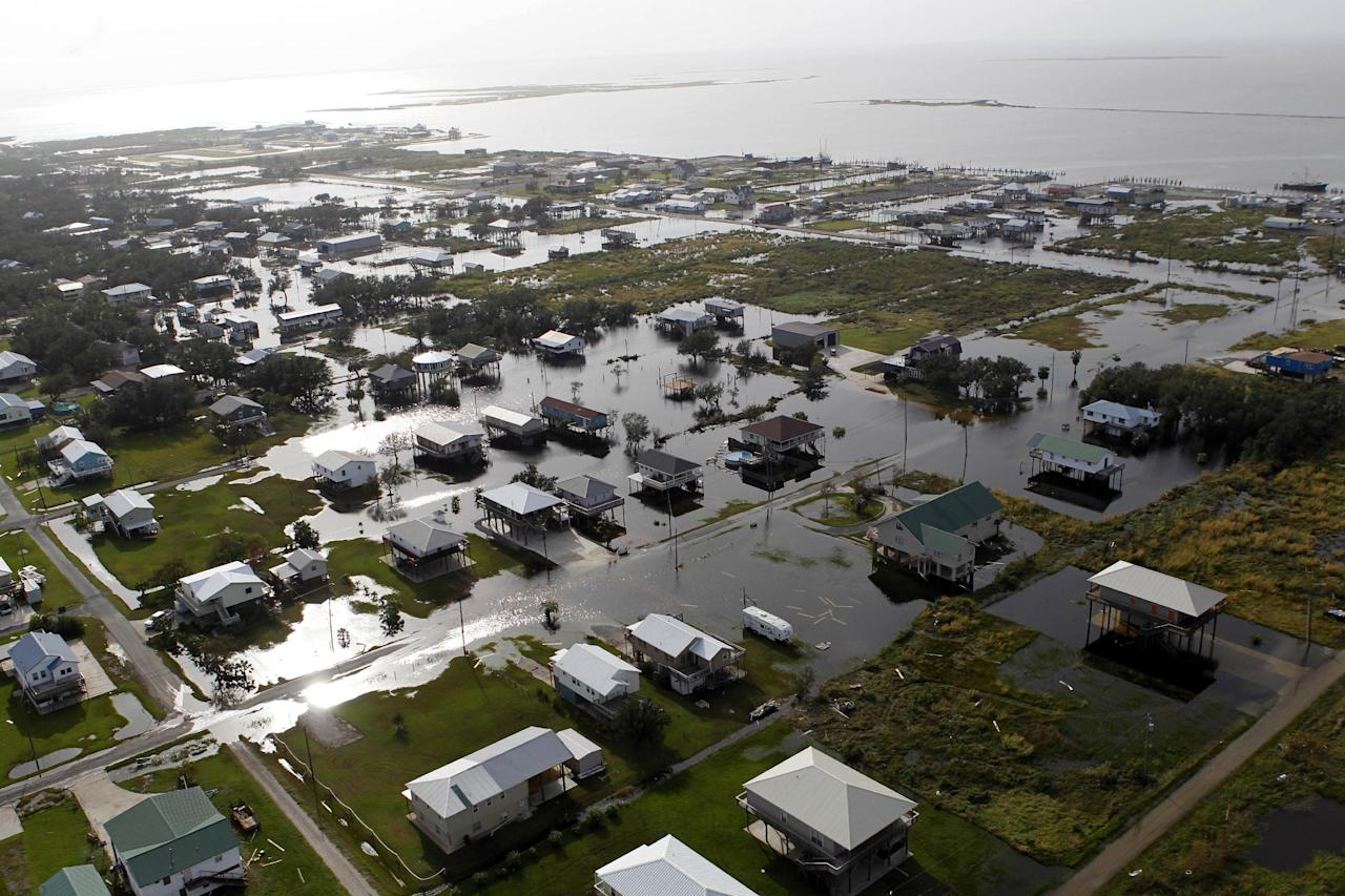 This aerial photo shows flooding from Grand Isle, La. in the aftermath of Isaac, Friday, Aug. 31, 2012. Isaac is now a tropical depression, with the center on track to cross Arkansas on Friday and southern Missouri on Friday night, spreading rain through the regions.(AP Photo/Gerald Herbert)