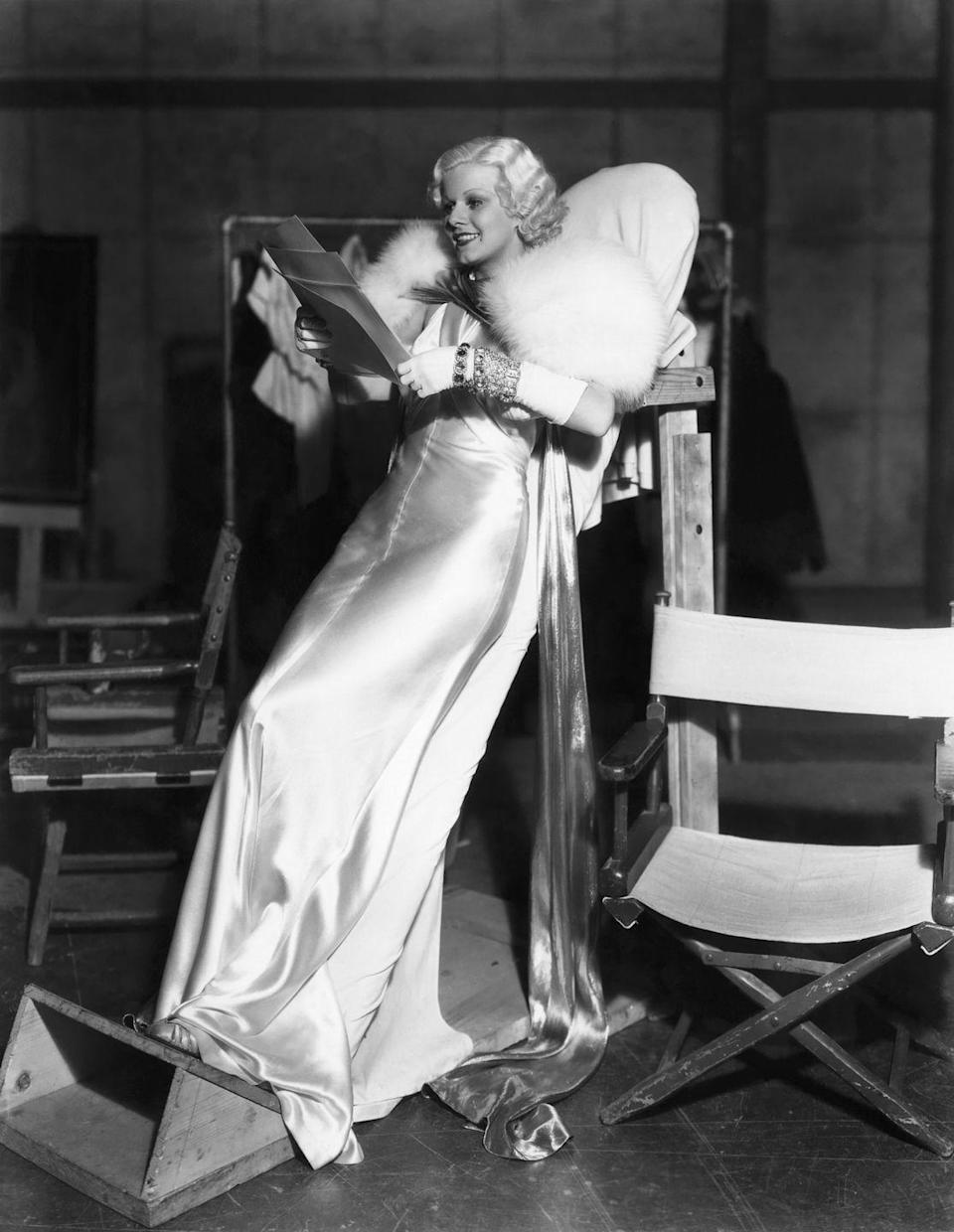 <p>Audiences expected Jean Harlow to bring the glamour while starring in <em>Dinner at Eight</em> as a sultry, social climbing wife. The film star delivered, showing off a wrist stacked with four diamond and gemstone bracelets, laid over a white satin glove. The art deco jewels were the perfect compliment to the iconic ensemble that Harlow is remembered for. </p>