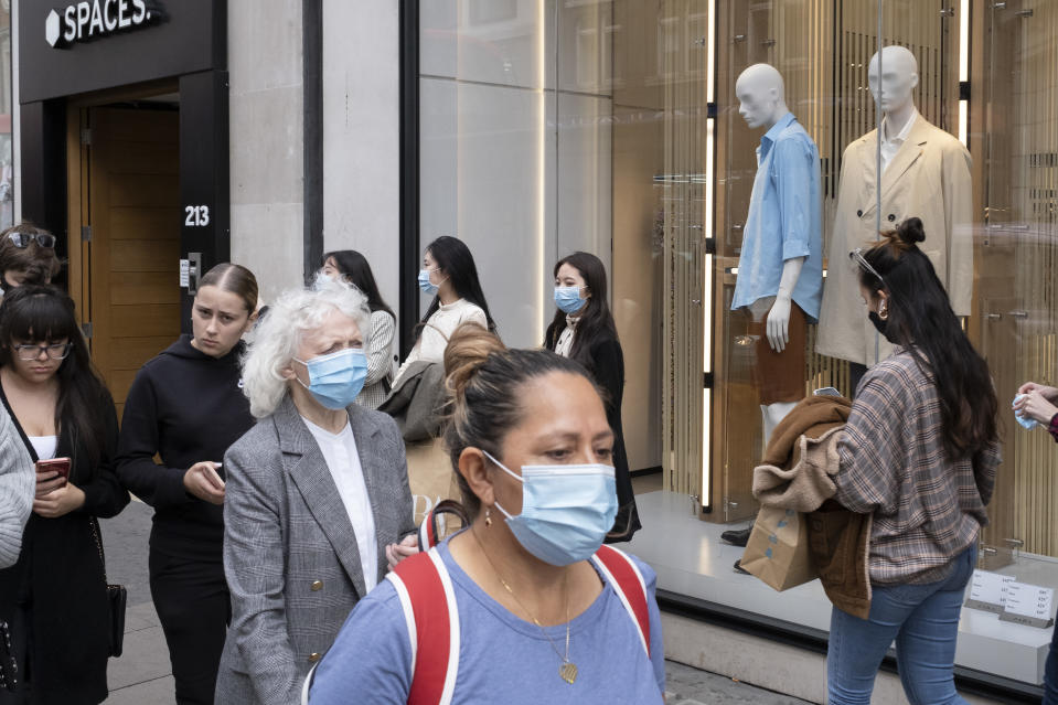 With most shops now open but with retail sales suffering due to the Coronavirus pandemic, shoppers wearing face maks, which will become compulsory in shops on the 24th July, still come to Oxford Street, London's main shopping district on 16th July 2020 in London, United Kingdom. Coronavirus or Covid-19 is a respiratory illness that has not previously been seen in humans. While much or Europe has been placed into lockdown, the UK government has put in place more stringent rules as part of their long term strategy, and in particular social distancing. (photo by Mike Kemp/In PIctures via Getty Images)