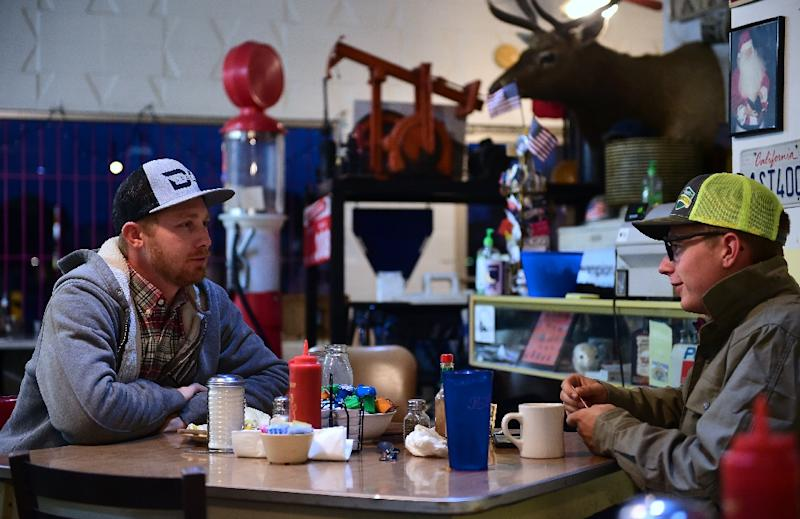 Laid off oil field worker Burt Reynolds (L) and his friend professional bull rider Lane Selz finish breakfast at Pappy's Coffee Shop, in Bakersfield, California (AFP Photo/Frederic J. Brown)