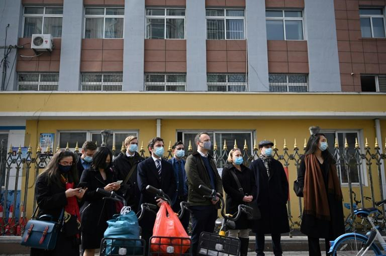 Diplomats from various countries waited outside of the Dandong Intermediate People's Court, where Canadian businessman Michael Spavor stood trial on spying charges, in the border city of Dandong in China's northeast Liaoning province