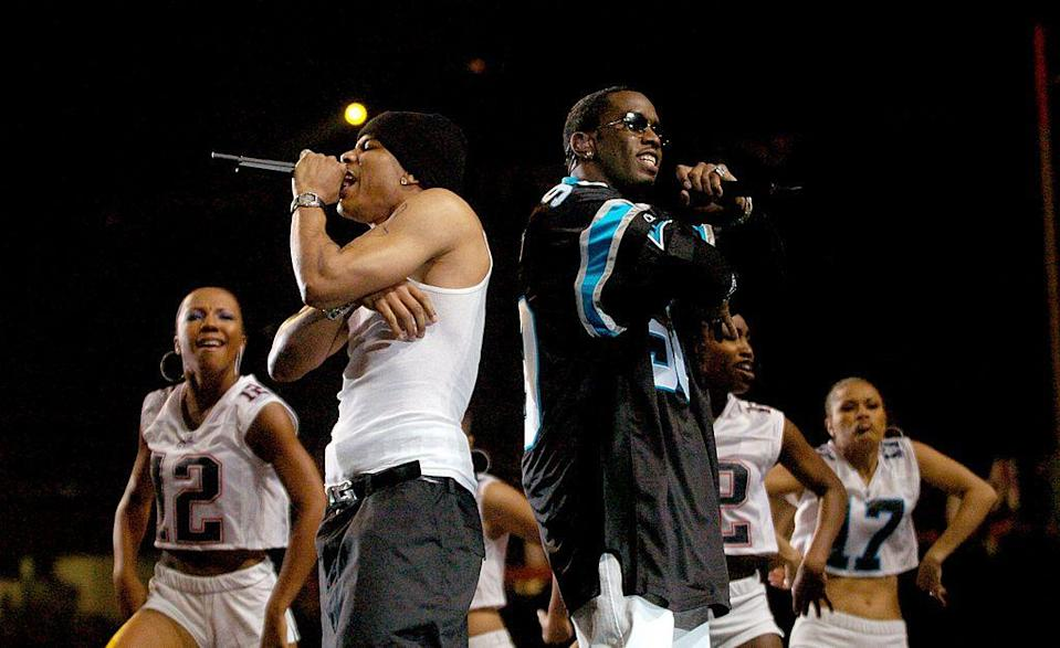 <p>The two rappers joined the show dressed in an oversized football jersey and a white vest.</p>