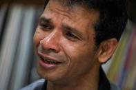 Rohingya refugee and activist Zafar Ahmad Abdul Ghani cries during an interview with Reuters at his home in Kuala Lumpur