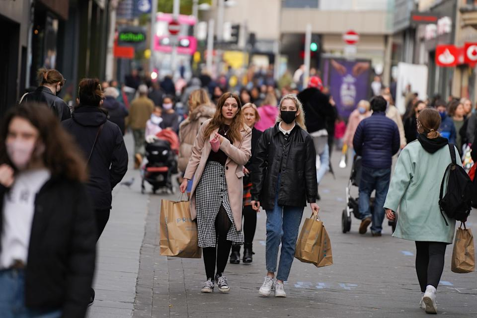 Shoppers wearing face masks walk through the streets of Nottingham on 28 October 2020. (Photo by Giannis Alexopoulos/NurPhoto via Getty Images)