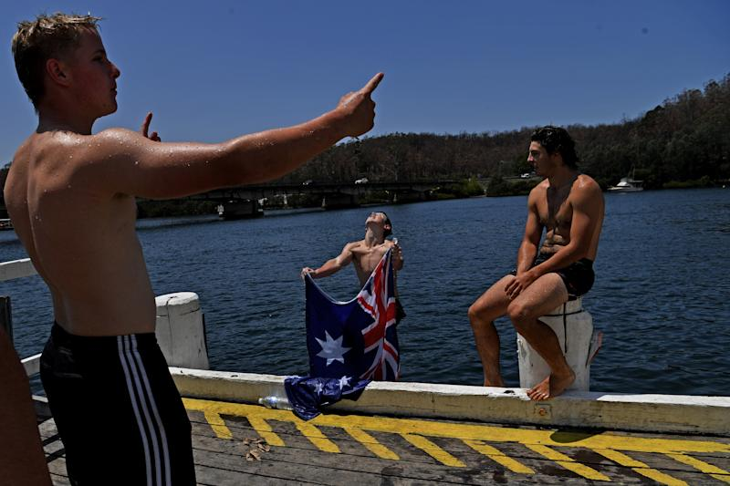 Residents cool off in the fire affected Clyde River near Batemans Bay on Australia Day.