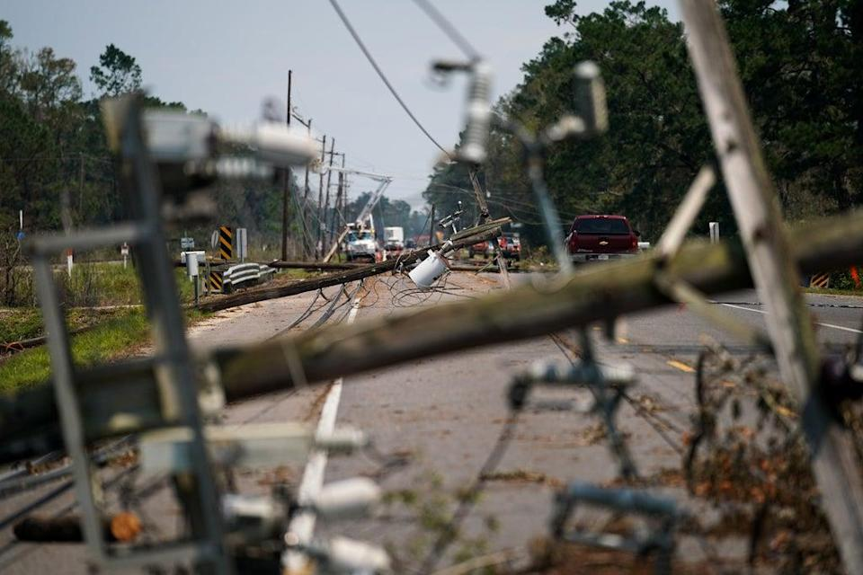Utility poles and transmission lines collapsed across south Louisiana during Hurricane Ida, stranding thousands of residents without power for days or weeks. (Getty Images)