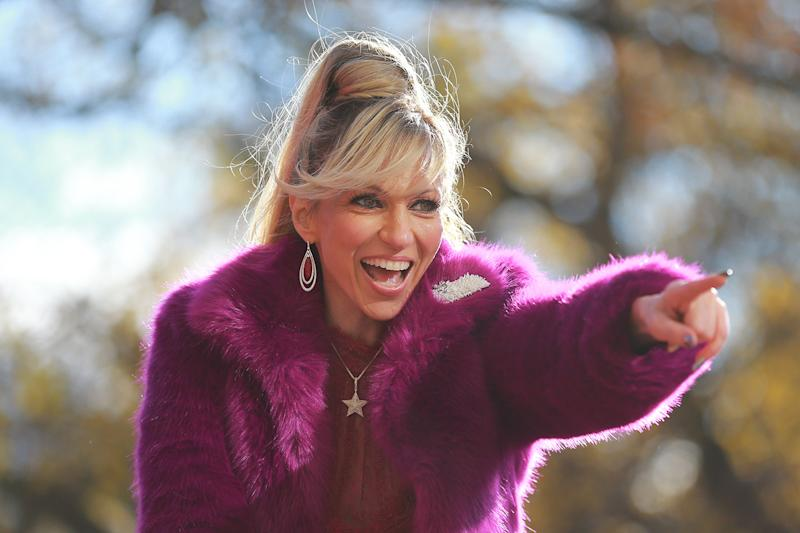 Entertainer Debbie Gibson points to fans while riding on board The Shimmer and Shine from Nickelodeon float in the 93rd Macy's Thanksgiving Day Parade in New York. (Photo: Gordon Donovan/Yahoo News)