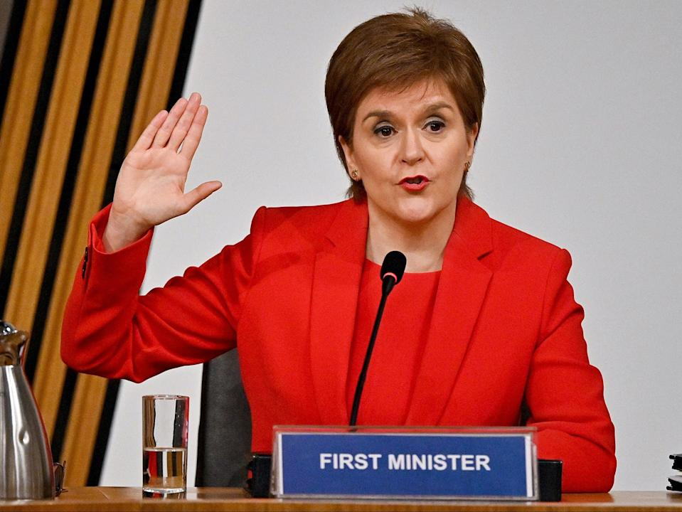 Nicola Sturgeon taking oath before giving evidence to the committee (PA)