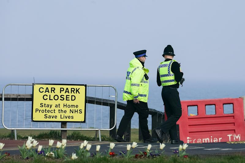Police officers close a car park in Whitley Bay, Northumberland, as the UK continues in lockdown to help curb the spread of the coronavirus. (Photo by Owen Humphreys/PA Images via Getty Images)