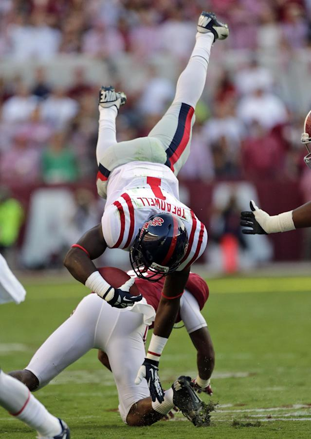 Mississippi wide receiver Laquon Treadwell (1) is upended by Alabama defensive back Ha Ha Clinton-Dix (6) during the first half of an NCAA college football game in Tuscaloosa, Ala., Saturday, Sept. 28, 2013. (AP Photo/Dave Martin)