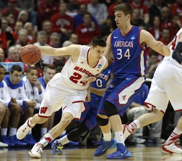 Wisconsin guard Bronson Koenig (24) drives against American center Tony Wroblicky (34) during the first half of a second-round game in the NCAA college basketball tournament Thursday, March 20, 2014, in Milwaukee. (AP Photo/Jeffrey Phelps)
