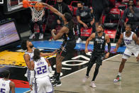Brooklyn Nets center DeAndre Jordan (6) dunks in front of Brooklyn Nets guard Bruce Brown (1) and Sacramento Kings forward Harrison Barnes (40) as Kings center Richaun Holmes (22) and guard De'Aaron Fox (5) look on during the first quarter of an NBA basketball game, Tuesday, Feb. 23, 2021, in New York. (AP Photo/Kathy Willens)
