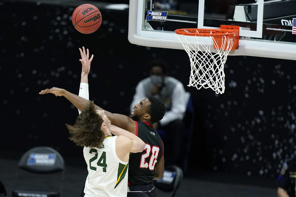 Baylor's Matthew Mayer (24) shoots against Hartford's Austin Williams (20) during the first half of a college basketball game in the first round of the NCAA tournament at Lucas Oil Stadium in Indianapolis Friday, March 19, 2021, in Indianapolis, Tenn. (AP Photo/Mark Humphrey)