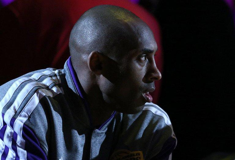 Kobe Bryant of the Lakers sits on the bench during introductions on March 3, 2013 in Los Angeles