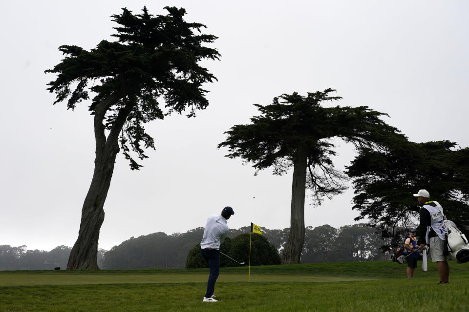 Scottie Scheffler chips to the green on the 18th hole during the third round of the PGA Championship golf tournament at TPC Harding Park Saturday, Aug. 8, 2020, in San Francisco. (AP Photo/Charlie Riedel)
