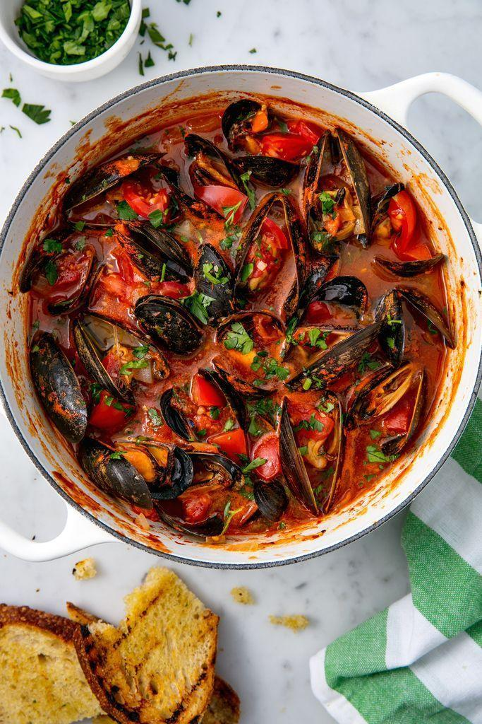 """<p>This dish will transport you straight to the Mediterranean seaside.</p><p>Get the <a href=""""https://www.delish.com/uk/cooking/recipes/a29184626/steamed-mussels-recipe/"""" rel=""""nofollow noopener"""" target=""""_blank"""" data-ylk=""""slk:Mussels with Tomatoes and Garlic"""" class=""""link rapid-noclick-resp"""">Mussels with Tomatoes and Garlic</a> recipe.</p>"""
