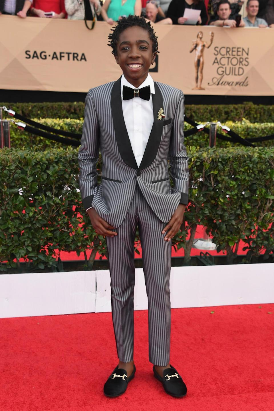 <p>Wearing a pin striped suit, paired with loafers. <em>[Photo: Getty]</em> </p>
