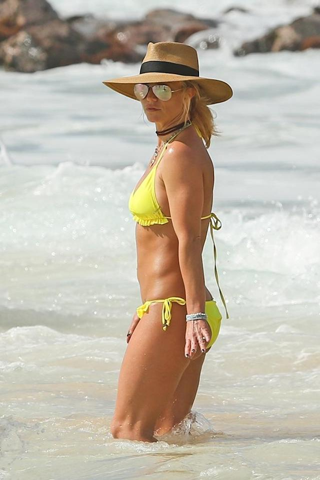 "<p>Is the pop superstar trying to tell us something? Brit, who showed off her fit physique in a bright yellow bikini, seemed to be wearing a ring on her left hand and has people wondering if she and <a href=""https://www.yahoo.com/lifestyle/britney-spears-tells-her-apos-125707770.html"" data-ylk=""slk:boyfriend Sam Asghari;outcm:mb_qualified_link;_E:mb_qualified_link"" class=""link rapid-noclick-resp newsroom-embed-article"">boyfriend Sam Asghari</a> have taken things to the next level. The pair celebrated their first anniversary in late November and appear to be inseparable. Could the third time be the charm for the mother of two? Stay tuned. (Photo: BackGrid) </p>"