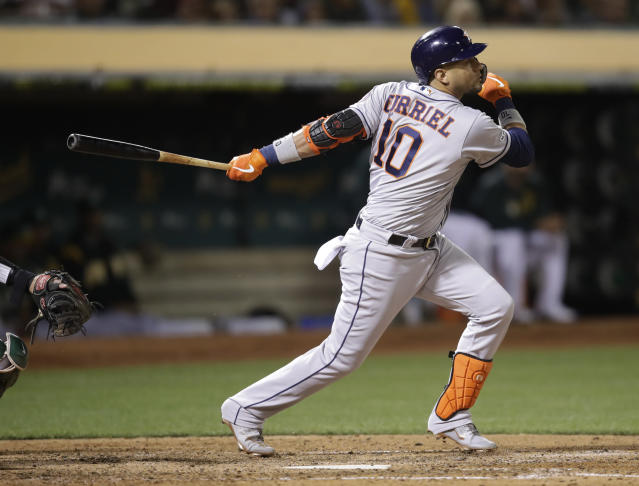 Houston Astros' Yuli Gurriel watches his RBI single off Oakland Athletics' Tanner Roark during the sixth inning of a baseball game Friday, Aug. 16, 2019, in Oakland, Calif. (AP Photo/Ben Margot)