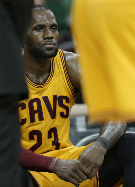 File-This April 7, 2017, file photo shows Cleveland Cavaliers' LeBron James sitting on the bench in the final minutes of the second half of an NBA basketball game against the Atlanta Hawks, in Cleveland. The Cavaliers have fallen back on excuses — some legitimate — to explain this disjointed season. Well, those don't matter now. James and the defending champs enter the playoffs staring at a possibly dangerous path. (AP Photo/Tony Dejak, File)