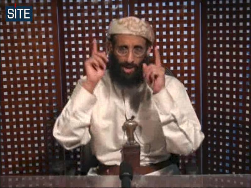 FILE - In this Nov. 8, 2010 file image taken from video and released by SITE Intelligence Group on Monday, Anwar al-Awlaki speaks in a video message posted on radical websites. Al-Awlaki, a key member of al-Qaida in the Arabian Peninsula, was killed on Sept. 30, 2011 in a drone strike in the mountains of Yemen. The 40-year-old American-Yemeni cleric emerged as an enormously influential preacher among militants living in the West, with his English-language Internet sermons calling for jihad, or holy war, against the United States. He was in contact with the accused perpetrators of the 2009 shooting rampage at Fort Hood that killed 13 people, the 2010 car bomb attempt in New York's Times Square and the Christmas 2009 attempt to blow up an airliner heading to Detroit.(AP Photo/SITE Intelligence Group, File)