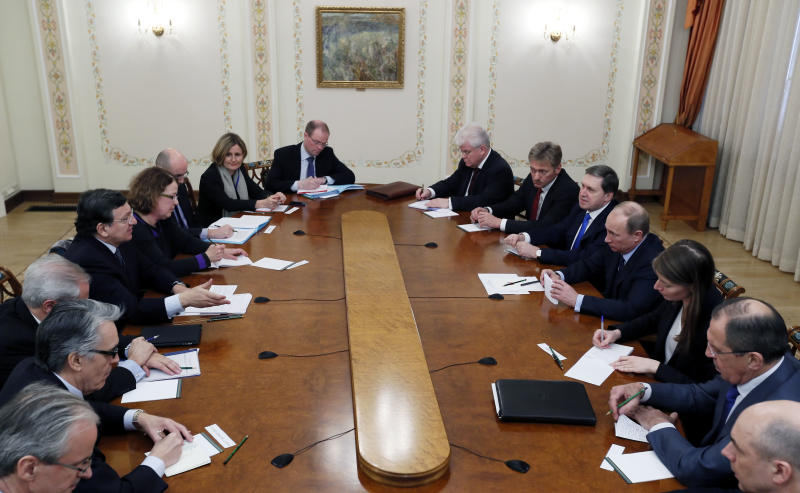 Russian President Vladimir Putin, fourth right, and European Commission President Jose Manuel Barroso, fourth left, meet in the Novo-Ogaryovo residence, outside Moscow, Russia, Thursday, March 21, 2013. The EU and Russia are having one of their biggest spats in recent times over the future of the Cypriot economy. (AP Photo/Yuri Kochetkov, Pool)
