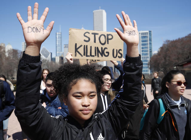 <p>A student holds up her hands while taking part in National School Walkout Day to protest school violence on April 20, 2018 in Chicago, Illinois. (Photo: Jim Young/Getty Images) </p>