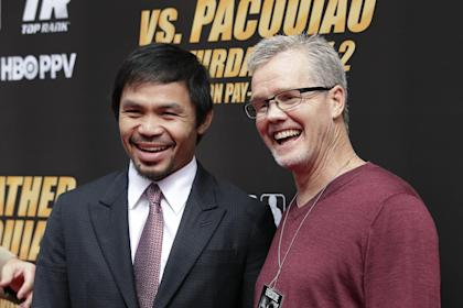 Manny Pacquiao (L) poses with trainer Freddie Roach after the press conference on Wednesday. (AP)