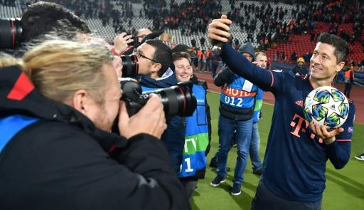 Bayern Munich's Polish forward Robert Lewandowski marks his four goals in 15 minutes on Tuesday by taking a selfie with the matchball in Belgrade