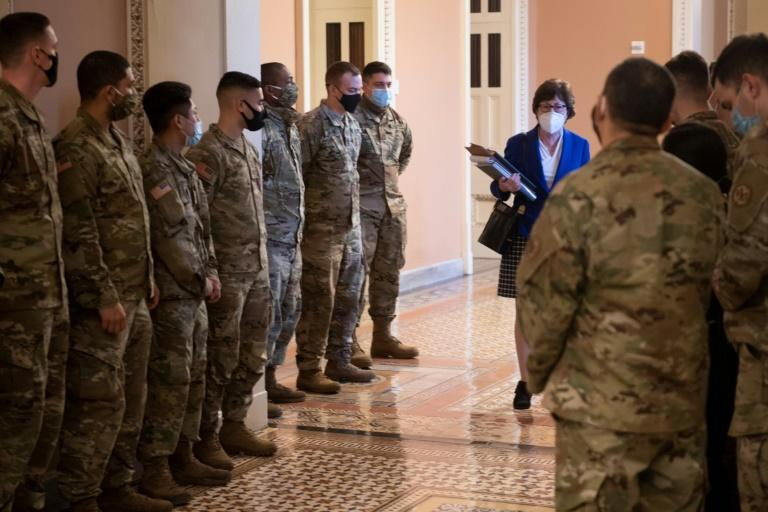 Republican Senator Susan Collins of Maine walks past members of the National Guard on the third day of former US president Donald Trump's impeachment trial