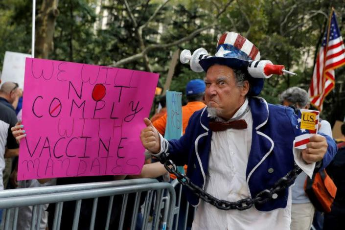 FILE PHOTO: Protest against mandated coronavirus disese (COVID-19) vaccines and vaccine passports at City Hall in Manhattan, New York City,