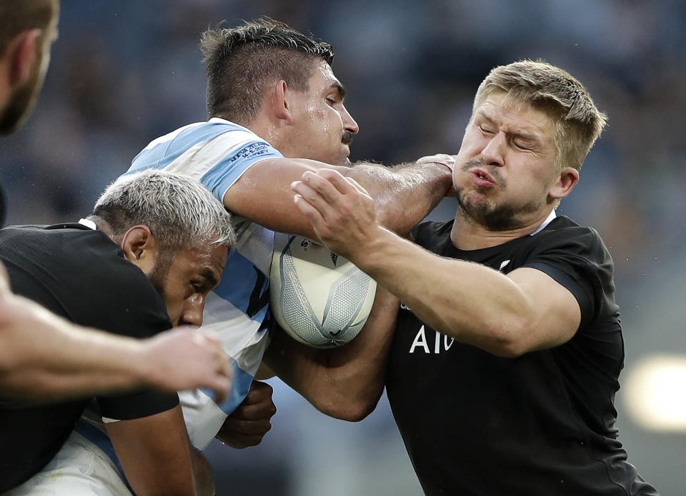 "FILE - In this Nov. 14, 2020, file photo, Argentina's Pablo Matera is tackled by New Zealand's Jack Goodhue, right, during the Tri-Nations rugby test between Argentina and New Zealand at Bankwest Stadium in Sydney, Australia. Matera has been stripped of the captaincy of the Argentina national rugby team and suspended along with two teammates over historic social media posts which have been deemed ""discriminatory and xenophobic."" (AP Photo/Rick Rycroft, File)"